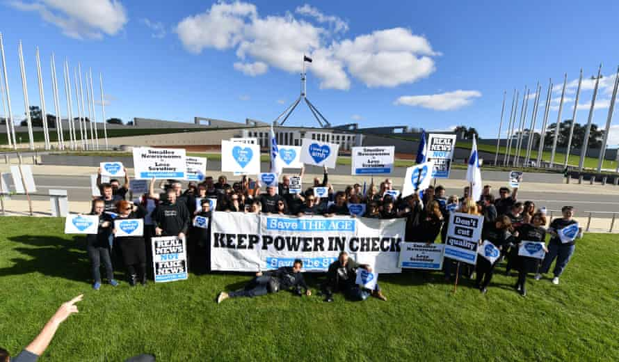 Journalists from the Sydney Morning Herald and the Age protest outside the Parliament House in Canberra on budget day.