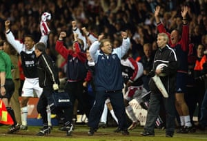 Neil Warnock and the Sheffield United bench celebrate at the final whistle.