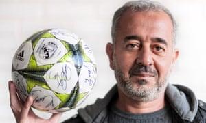 Osama Abdul Mohsen with signed football