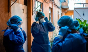 A health brigade gets ready while on door-to-door visits to carry out Covid-19 tests in Mexico City, on 16 June 2020.