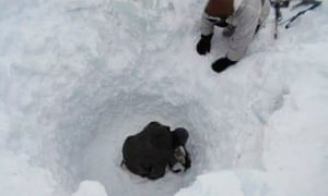 Indian army personnel search for survivors after the deadly avalanche on the Siachen glacier in Kashmir.