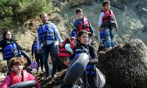 Syrian migrants wear life-jackets before boarding a dinghy to cross the Aegean Sea to the Greek island of Lesbos from the Ayvacik coast in Canakkale in 2016.