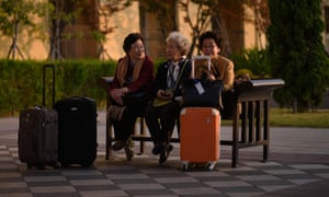 """A group of South Korean women sit on a bench outside their hotel before departing for the border. The meeting was organised by the Red Cross and agreed <a href=""""http://www.theguardian.com/world/2015/sep/08/more-korean-family-reunions-to-be-held-after-border-talks-produce-agreement"""">during peace talks</a> between Pyongyang and Seoul in August"""