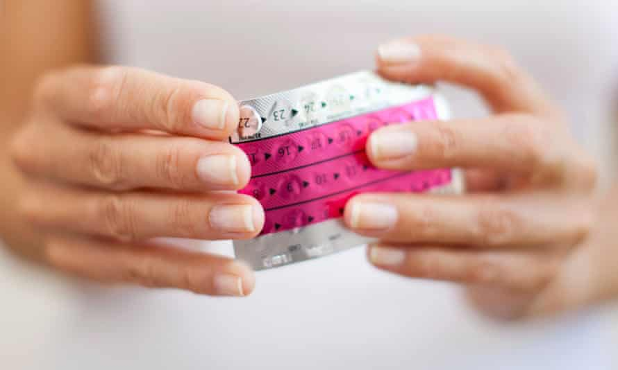 Woman's hands holding a packed of birth control pills.
