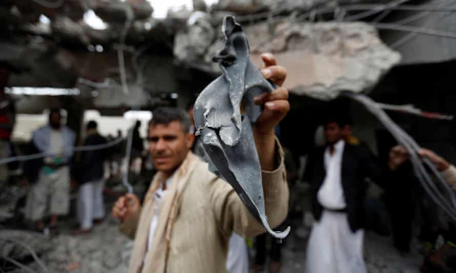 A man shows a fragment of a missile he picked up at a building destroyed by Saudi-led air strikes in the northwestern city of Amran, Yemen.