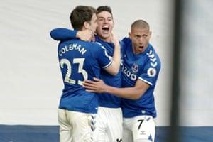 James Rodriguez of Everton (C) celebrates with teammates Seamus Coleman and Richarlison after scoring.
