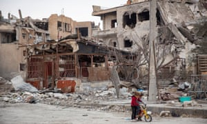 Syria conflictAmnesty International handout photo dated 02/2018 of children riding a bicycle next to destroyed buildings in Raqqa, Syria. The US-led coalition campaign to liberate the city from the clutches of Islamic State killed hundreds of civilians and injured thousands, the charity has claimed. PRESS ASSOCIATION Photo. Issue date: Tuesday June 5, 2018. See PA story DEFENCE Raqqa. Photo credit should read: Amnesty International/PA Wire NOTE TO EDITORS: This handout photo may only be used in for editorial reporting purposes for the contemporaneous illustration of events, things or the people in the image or facts mentioned in the caption. Reuse of the picture may require further permission from the copyright holder.