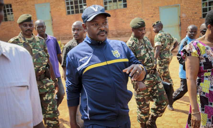 President Pierre Nkurunziza walks to a polling station to cast his vote for the presidential election, in his hometown of Ngozi, Burundi, 21 July 2015.