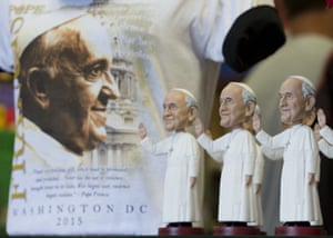 A T-shirt and Pope Francis bobbleheads are displayed at a souvenir store in Washington DC