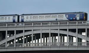 A Northern train crosses the High Level Bridge between Newcastle and Gateshead