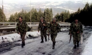 Bosnian Serb soldiers pass the Olympic bobsleigh track on Mount Trebević in February 1994, at the height of the conflict.