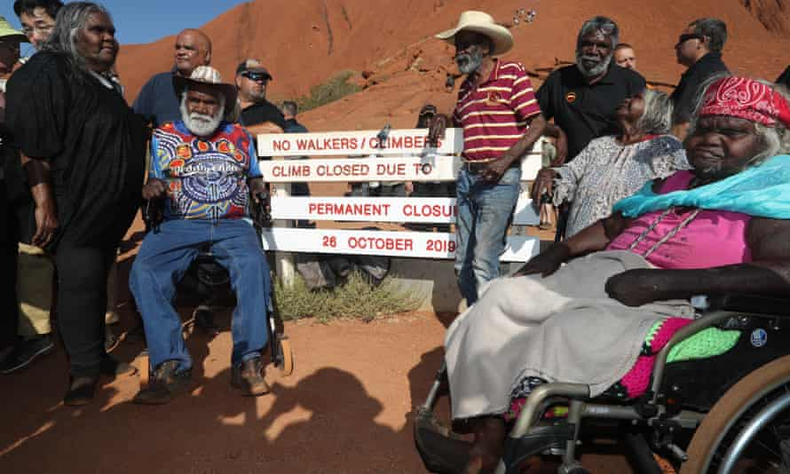 Traditional owners of Uluru gather around the base of the climb after it was permanently closed.