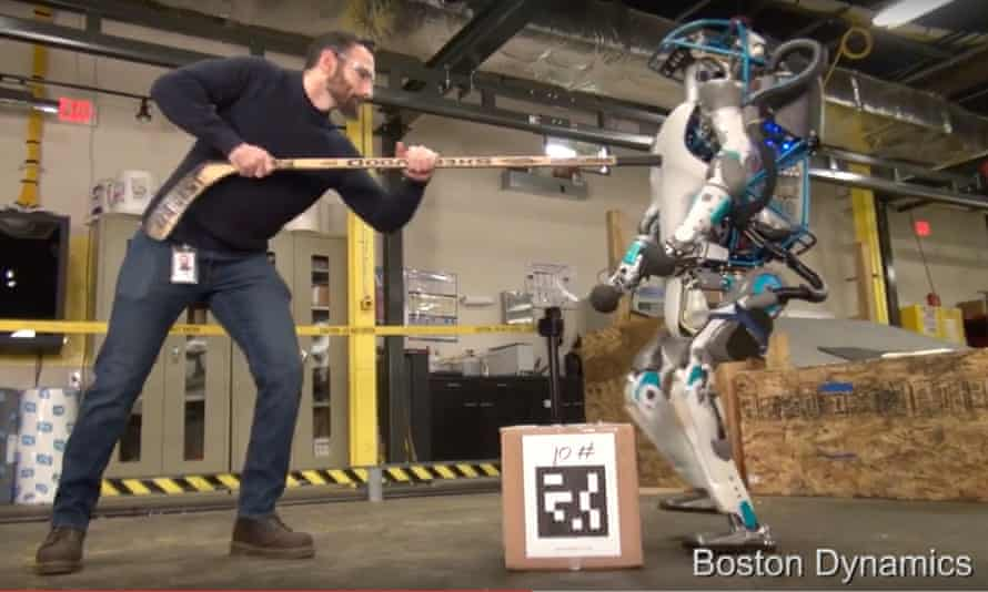 Atlas, the Boston Dynamics robot, being hit with a hockey stick.