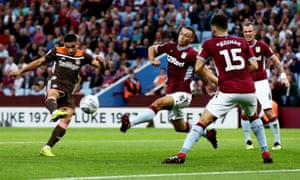 Neal Maupay (left) scored twice for Brentford but was lucky to stay on the field after a challenge on Villa's John McGinn.