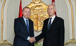 Turkey's president, Recep Tayyip Erdoğan (left), meets his Tunisian counterpart, Kais Saied, in Tunis.