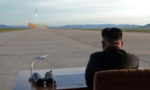 North Korean leader Kim Jong-un inspects a missile launch in this undated image. China has urged the US to stop threatening Pyongyang.