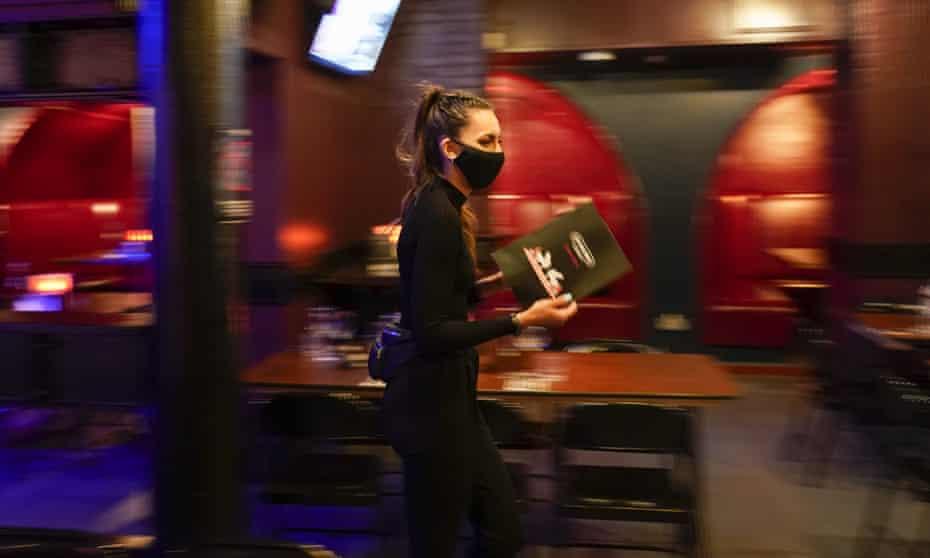 Member of staff walking through restaurant