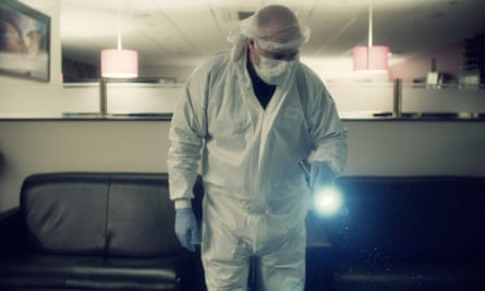 A crime scene manager looking for evidence in Forensics: The Real CSI.