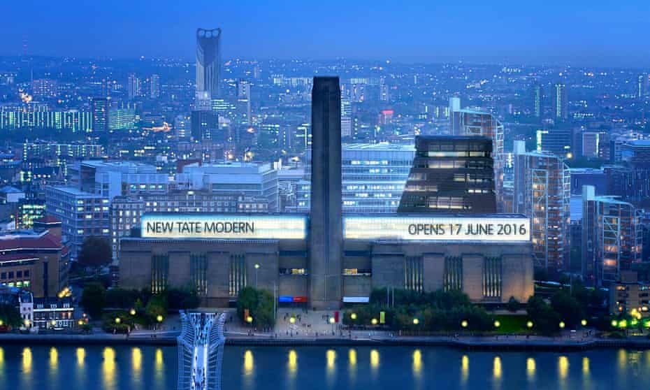 Aerial nighttime view of the illuminated exterior of the Tate Modern art gallery in London. A neon sign at the top of the building reveals a date of 17 June 2016 when the gallery is set to open its new extension.