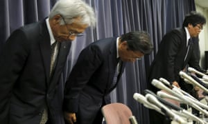Mitsubishi Motors Corp's president Tetsuro Aikawa bows with other company executives at a news conference