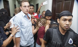 Canadians plead guilty in Malaysian nudity case