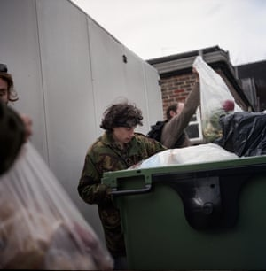 James, Thorn, Rob, and Andy search for food from the dumpster of a Maloney's Budgens in Virginia Water