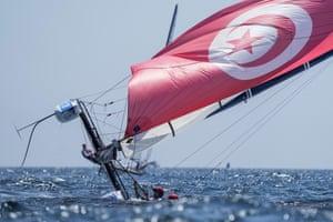 Tunisia's Mehdi Gharbi and Rain Rahali capsize during the Nacra race at the Enoshima harbour.