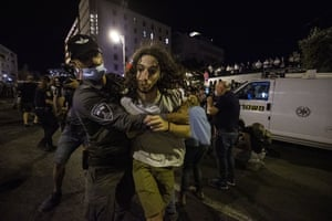 Security forces take a protester take into custody