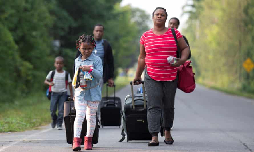 A family from Haiti walk to the US-Canada border to cross into Canada from Champlain, New York, U.S. August 11, 2017.