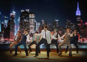 A suited and booted BTS perform Dynamite.