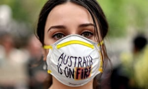 A demonstrator with a mask attends a climate protest rally in Sydney last Wednesday as bushfire smoke choked the city and the Australian government used the COP25 Madrid climate talks in Spain to push for dodgy accounting tricks to halve it climate effort.