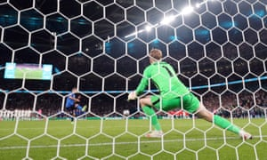 Italy's Domenico Berardi scores a penalty during a penalty shootout.