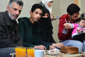 Mohammed Omran Injeela shares cake and fruit juice with his family