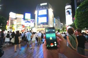 People play Pokémon Go in Tokyo, Japan.
