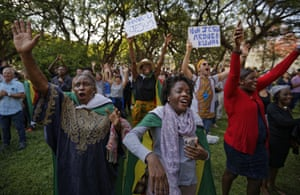 Zimbabweans sing and pray at a Christian peace and prayer rally in downtown Harare