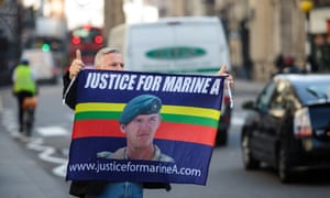 A supporter of Blackman holds up a banner outside the Royal Courts of Justice.