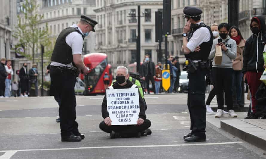 A man protests against the climate crisis in London.