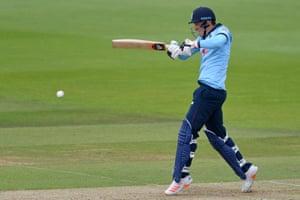 England's Tom Banton plays a shot for four.