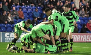 The Forest Green players pile on top of Elliott Frear after his late goal sent the non-league side into the FA Cup second round.