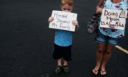Derrick Slaughter attends the Hope Not Heroin march, through the streets of Norwalk, Ohio, with his grandmother on 14 July 2017 in Norwalk, Ohio.