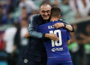 Chelsea's Eden Hazard is embraced by manager Maurizio Sarri after being is substituted off.
