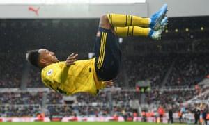 Pierre-Emerick Aubameyang celebrates his winning goal in typically acrobatic fashion.