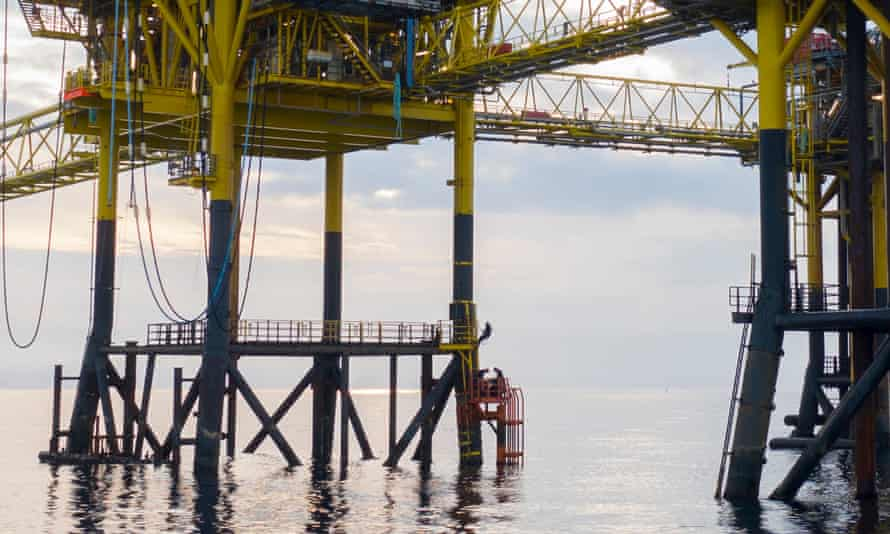 Four activists with Greenpeace Denmark at the Dan oil field in the Danish North Sea