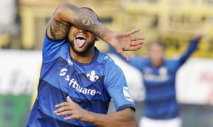 Darmstadt's Terrence Boyd celebrates after scoring the opening goal against Borussia Dortmund.