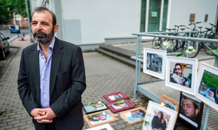 Bunni, with photographs of victims of the Syrian regime, outside the trial in Germany in June.