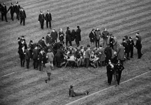 Police move in to tackle anti-apartheid demonstrators who invaded during South Africa's game against London Counties at Twickenham.