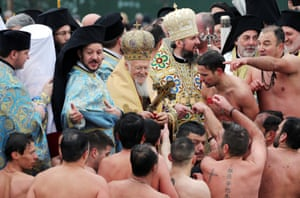 Istanbul, Turkey. Patriarch Bartholomew greets Greek Orthodox swimmers at the Golden Horn during the Epiphany celebration