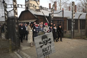 Oświęcim, Poland Poland's president Andrzej Duda walks with survivors through the gates of the Auschwitz Nazi extermination camp for a ceremony marking the 75th anniversary of its liberation