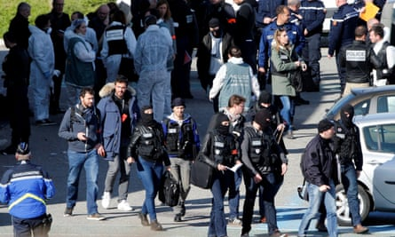 Police officers and investigators outside the supermarket in Trèbes on Friday.