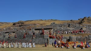 The Sapa Inca raises a cup of chicha, an alcoholic drink made of maize and used in ceremonies, before pouring it as an offering to the Inti, the sun god. The spectacle is acted out before thousands of tourists and local people at Sacsayhuaman, the Inca fortress above the city of Cusco.